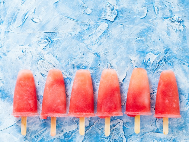Top view of watermelon popsicles with copy space