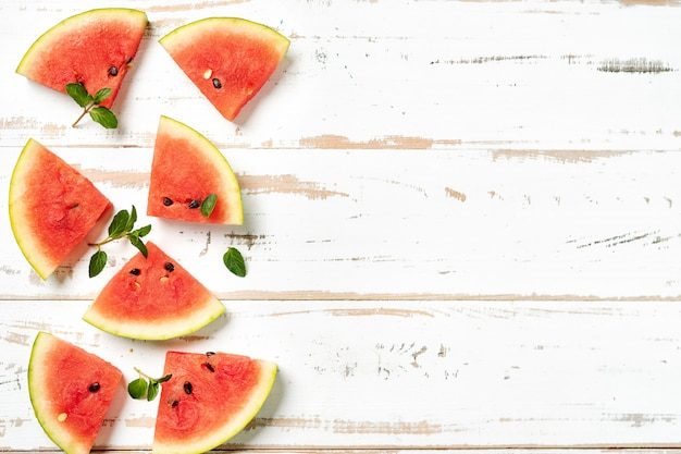 Top view of watermelon slices on white background