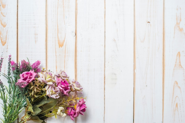 Top view of wedding flowers on white wood background
