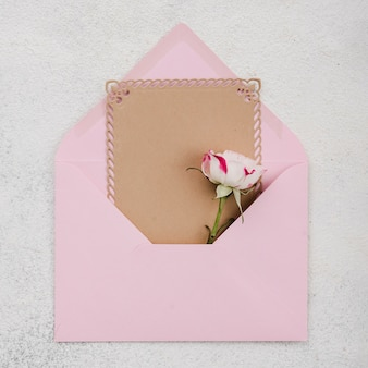 Top view wedding invitation card with flowers