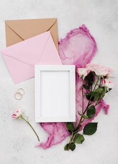 Top view wedding invitation cards with rings