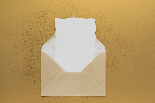 Top view wedding invitation in envelope