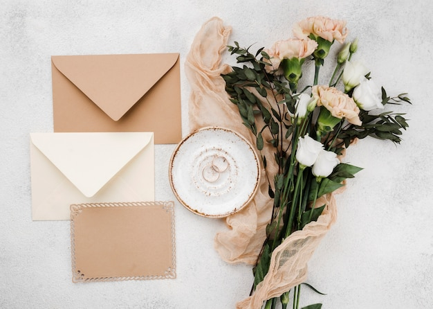 Top view wedding invitation envelopes with flowers