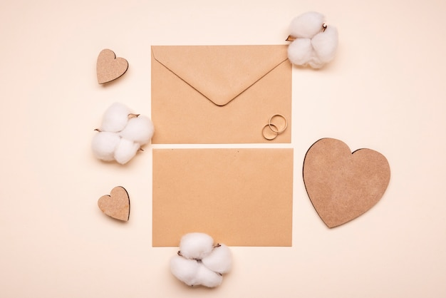 Top view wedding invitation with engagement rings