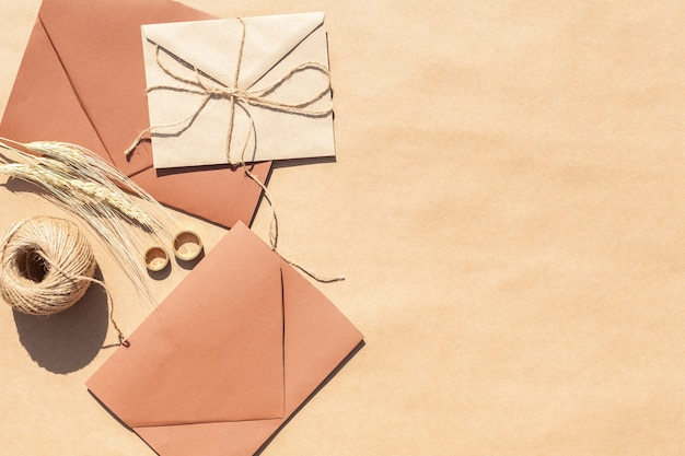 Top view wedding invitations in envelopes with copy space