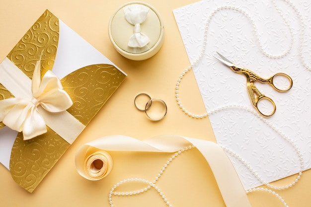 Top view wedding rings and ribbon with scissors