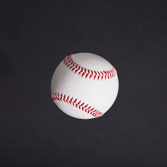 Top view of white baseball on black background
