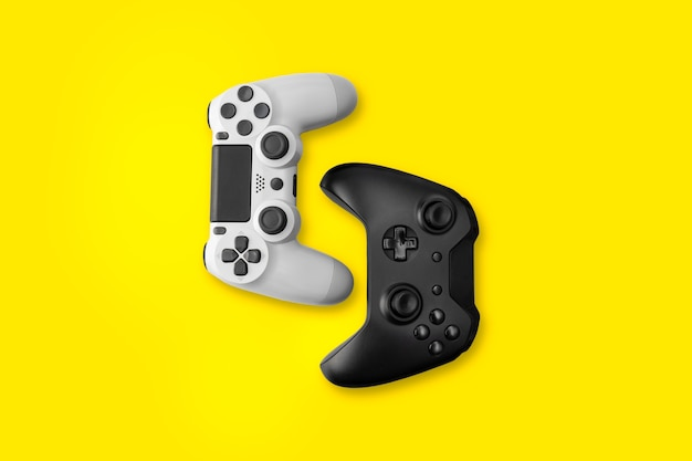 Top view of white and black game controllers