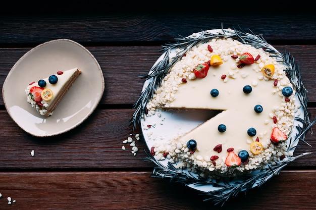 Top view white chocolate cake cut piece
