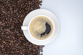 Top view. White cup of coffee on White background