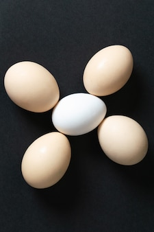 A top view white eggs raw whole on dark