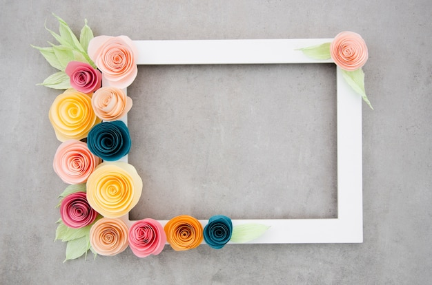 Top view white elegant floral frame on cement background