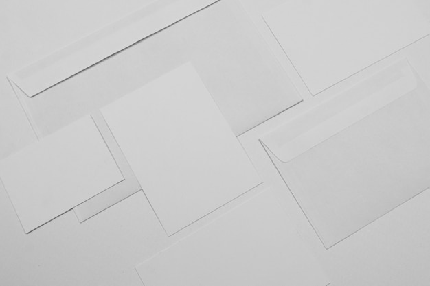 Top view white envelopes and paper sheets