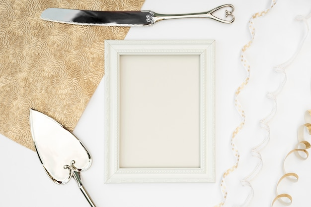 Top view white frame with cutlery