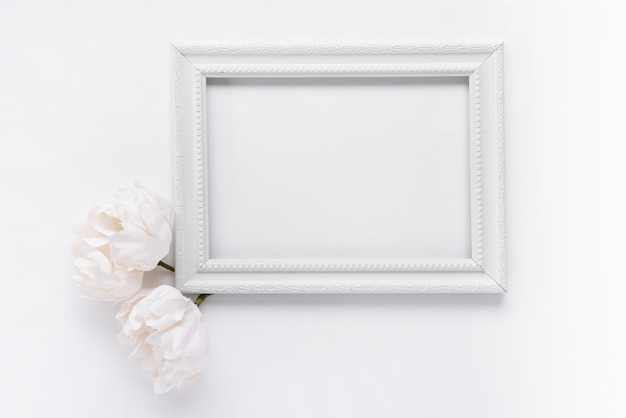Top view white frame with flowers