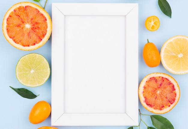 Top view white frame with organic fruits
