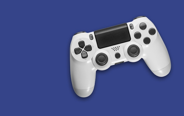 Top view of white game controller on blue space
