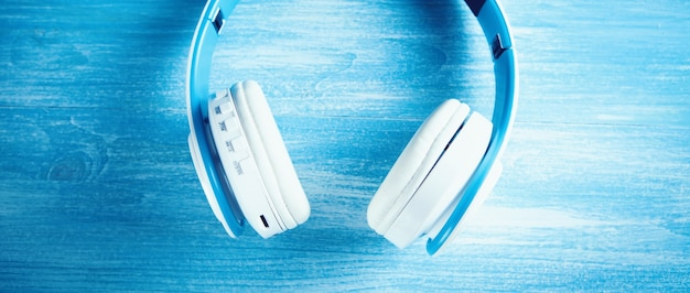 Top view of white headphones background