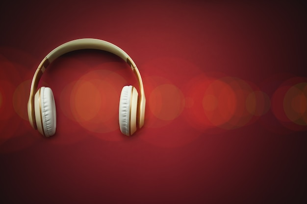 A top view of a white headphones. online music player app.