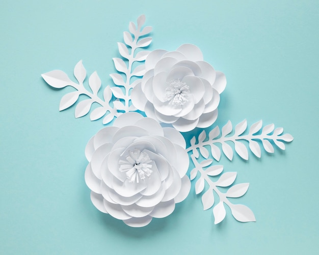 Top view of white paper flowers for women's day
