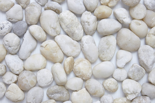 Top view white pebble stones in different size for decoration