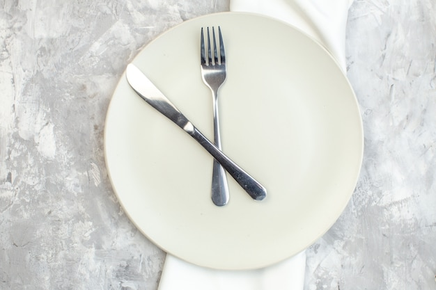 Top view white plate with fork and knife on light background kitchen food colour meal horizontal glass femininity