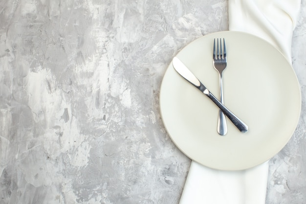 Top view white plate with fork and knife on light background kitchen food colour meal horizontal ladies glass femininity