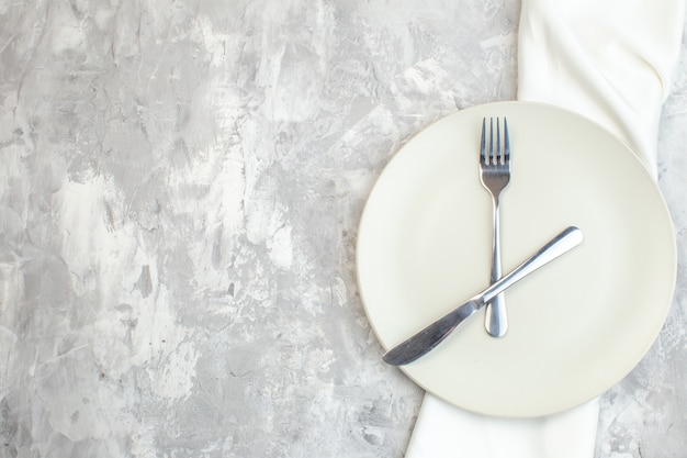 Top view white plate with fork and knife on light background kitchen food femininity colour meal horizontal glass