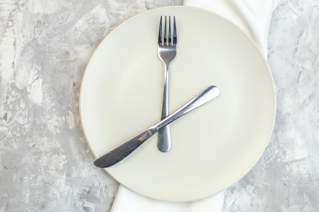 Top view white plate with fork and knife on light background kitchen food femininity colour meal horizontal ladies glass photo