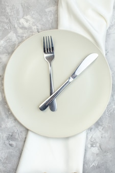 Top view white plate with fork and knife on light background kitchen food glass colour meal horizontal ladies