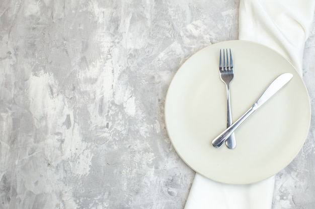 Top view white plate with fork and knife on light background kitchen food glass femininity colour meal ladies
