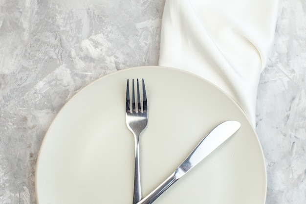 Top view white plate with fork and knife on light background kitchen food glass femininity meal horizontal ladies
