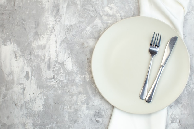 Top view white plate with fork and knife on light background kitchen glass ladies femininity food colour meal horizontal