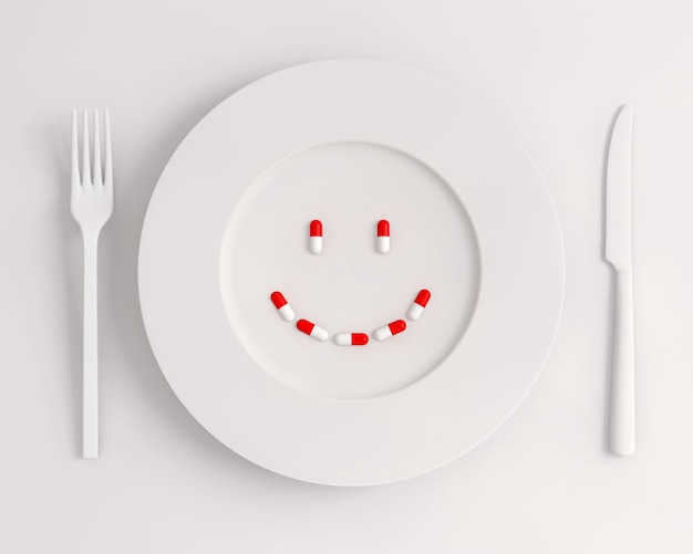 Top view white plate with pills forming a smile fork and knife