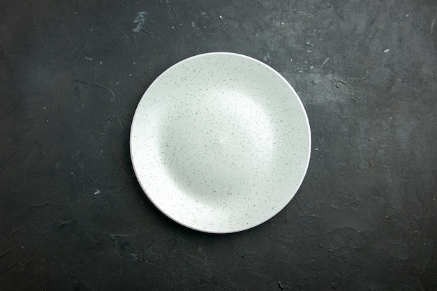 Top view white round plate on dark table with copy place