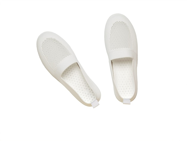 Top view of white sneakers made of mesh fabric isolated on a white background. lightweight women's shoes.