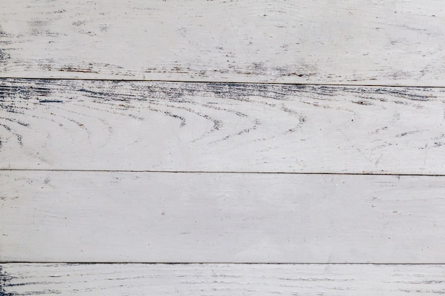 Top view of the white wooden table surface background.