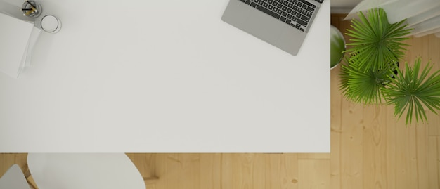 Top view of a white working desk with laptop computer and empty space for montage 3d rendering