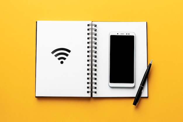 Top view of wi-fi symbol with notebook and smartphone
