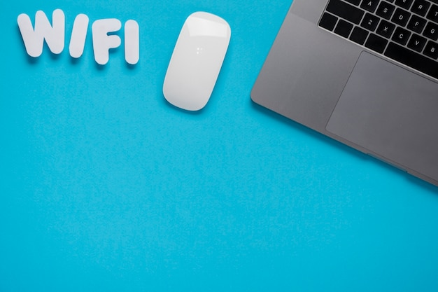 Top view wifi spelled on desk with laptop