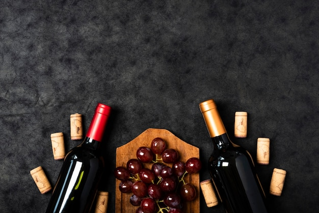 Top view wine bottles with grapes