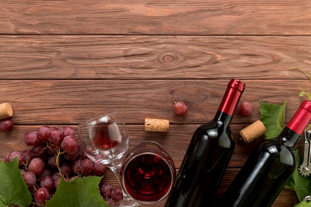 Top view wine bottles on wooden background