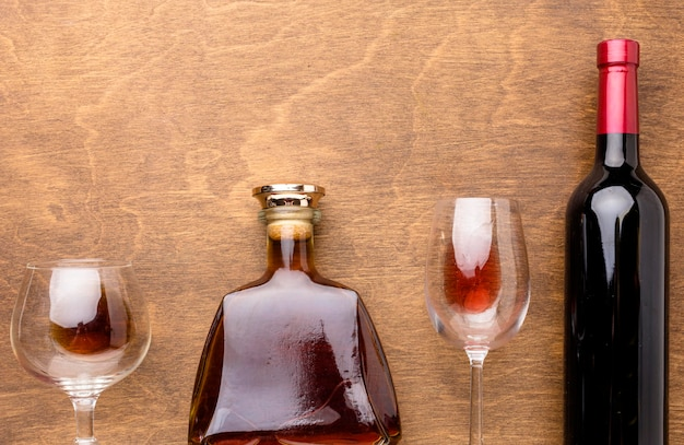 Top view wine and cognac bottles with glasses