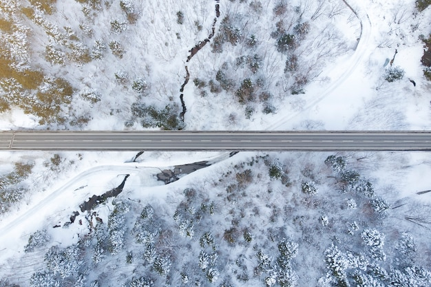 Top view of winter forest and road