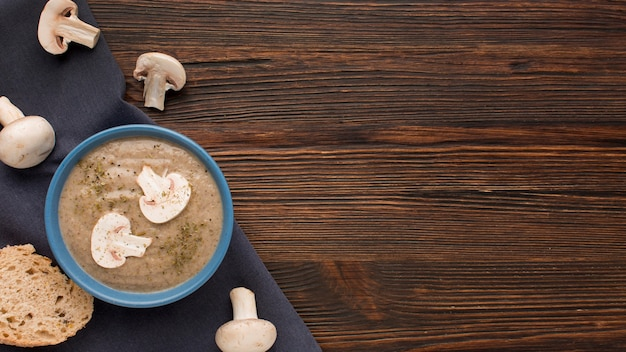 Top view of winter mushroom soup in bowl with copy space