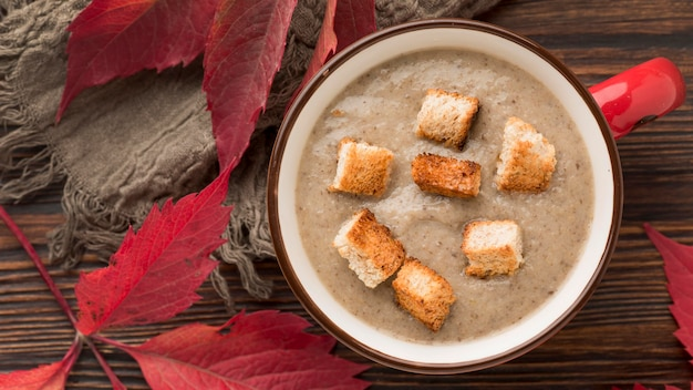 Top view of winter mushroom soup with croutons
