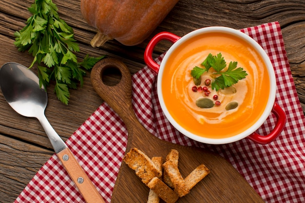Top view of winter squash soup with croutons