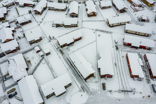 Top view of the winter village with snow covered houses and roads, view from above