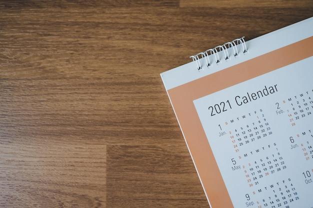 Top view with calendar 2021 month on wooden floor