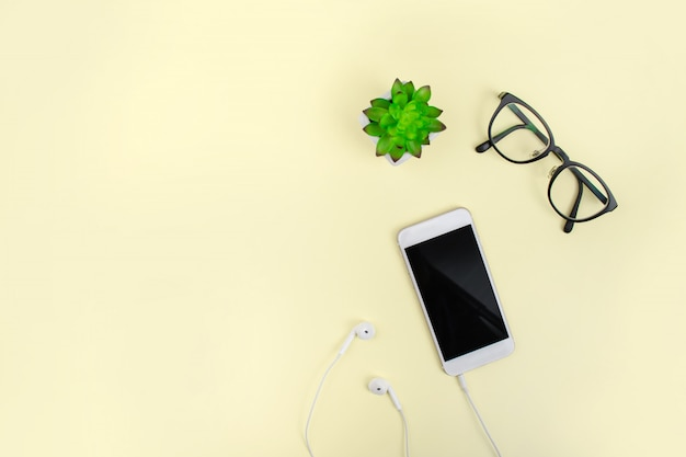 Top view with eyeglasses and smartphone